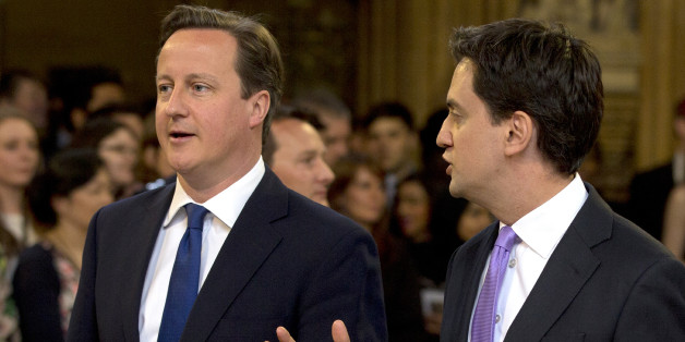 British Prime Minster David Cameron (L) and Ed Miliband, the Leader of the Labour Party, walk through the Members' Lobby to listen to the Queen's Speech at the State Opening of Parliament on May 8, 2013. Heir to the throne Prince Charles and his wife Camilla attended the state opening of Britain's parliament alongside Queen Elizabeth II on Wednesday, in a sign of their increasing role as the 87-year-old monarch scales back some of her duties.   AFP PHOTO / ALASTAIR GRANT/POOL        (Photo credi
