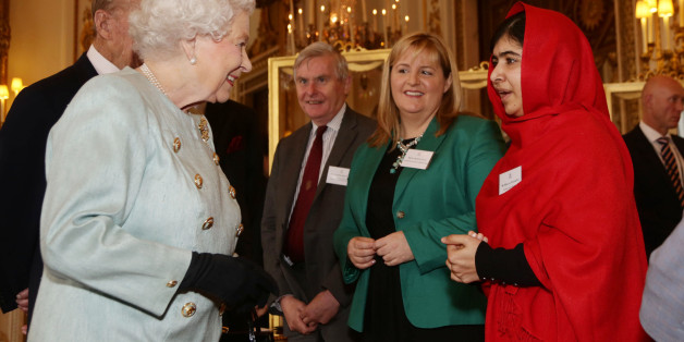 Queen Elizabeth II meeting Malala Yousafzai during a Reception for Youth, Education and the Commonwealth at Buckingham Palace, London.