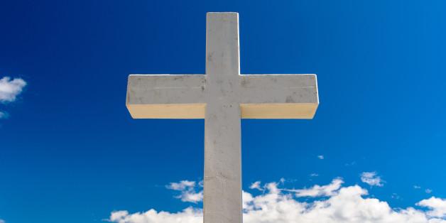 white cross against blue sky...
