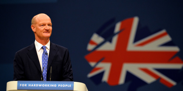 David Willetts, Minister of State for Universities and Science speaks at the Conservative Party Conference in Manchester, north -west England on September 30, 2013.  Britons who are out of work for several years will be required to work full-time on community projects to receive state unemployment payments, finance minister George Osborne will announce at the party's annual conference in Manchester, northwest England, in a bid to woo traditional conservative voters ahead of the 2015 general elec