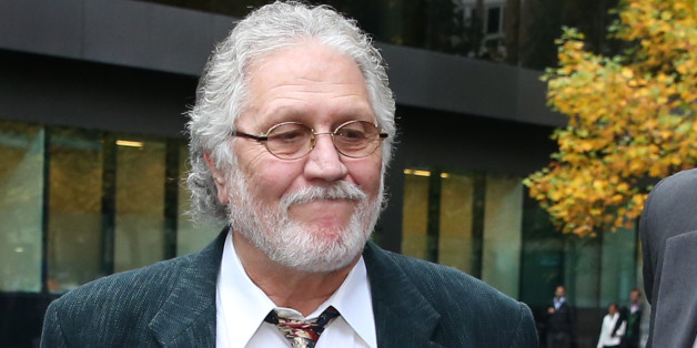 LONDON, ENGLAND - OCTOBER 22:  Former Radio One disc jockey Dave Lee Travis arrives at Southwark Crown Court on October 22, 2013 in London, England. Mr Travis' lawyers are attempting to reduce the number of charges he faces in connection with allegations of indecent and sexual assault.  (Photo by Peter Macdiarmid/Getty Images)