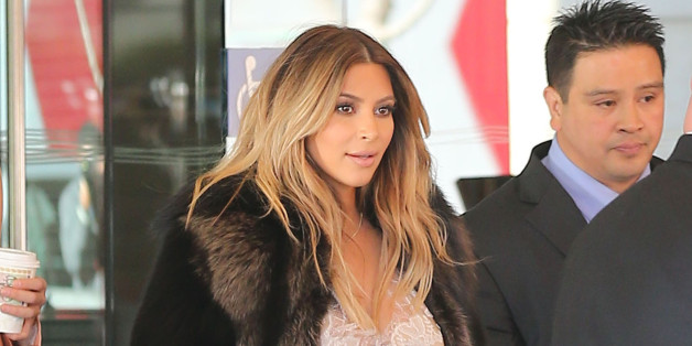 Kim Kardashian Looks Glam In Fur Coat After Getting Engaged To Kanye West