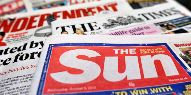 Detailed view of a pile of National newspapers including The Times, The Independent, The Sun and the Daily Mirror