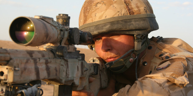 British army sniper peers through the scope of his rifle, to scan the horizon for suspected Taliban insurgents, north of Musa Qala in Helmand, Afghanistan.  Musa Qala town was one of the most bitterly contested parts of Helmand, which itself was one of the most dangerous places in Afghanistan. Hundreds of British and American soldiers and marines, and countless Afghan civilians, were killed in gun battles, ambushes, air strikes and by improvised explosive devices after the US led invasion toppled the Taliban regime in 2001.