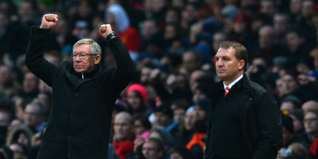 Manchester United's Scottish manager Alex Ferguson (L) celebrates next to Liverpool's Northern Irish manager Brendan Rodgers (R) during the English Premier League football match between Manchester United and Liverpool at Old Trafford in Manchester, northwest England, on January 13, 2013. AFP PHOTO/ANDREW YATES  == RESTRICTED TO EDITORIAL USE. No use with unauthorized audio, video, data, fixture lists, club/league logos or ?live? services. Online in-match use limited to 45 images, no video emulat