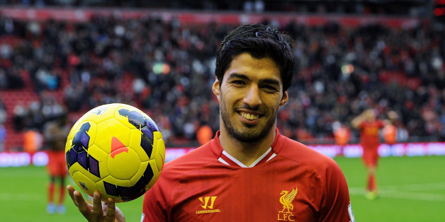 LIVERPOOL, ENGLAND - OCTOBER 26:  ( THE SUN OUT, THE SUN ON SUNDAY OUT) Luis Suarez of Liverpool poses with the match ball after scoring a hat trick at the end of the Barclays Premier League match between Liverpool and West Bromwich Albion at Anfield on October 26, 2013 in Liverpool, England.  (Photo by John Powell/Liverpool FC via Getty Images)