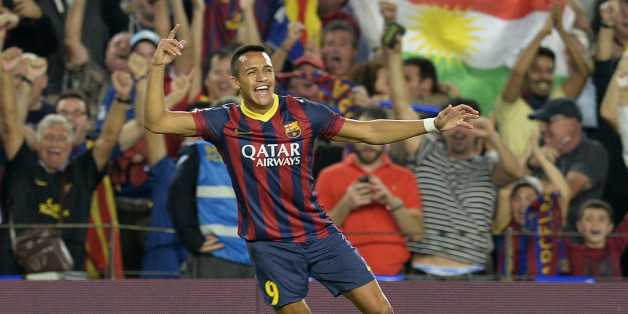 Barcelona's Chilean forward Alexis Sanchez celebrates after scoring during the Spanish league Clasico football match FC Barcelona vs Real Madrid CF at the Camp Nou stadium in Barcelona on October 26, 2013.   AFP PHOTO/ LLUIS GENE        (Photo credit should read LLUIS GENE/AFP/Getty Images)
