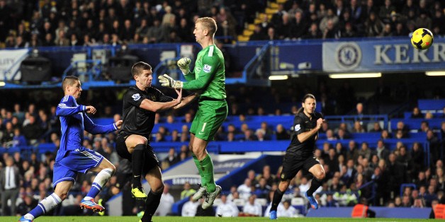 Manchester City's Serbian defender Matija Nastasic (2nd L) heads the ball back past his own goalkeeper Manchester City's English goalkeeper Joe Hart (3rd L), allowing Chelsea's Spanish striker Fernando Torres (L) to score the winning goal of the English Premier League football match between Chelsea and Manchester City at Stamford Bridge in west London on October 27, 2013. Chelsea won the game 2-1. AFP PHOTO/GLYN KIRKRESTRICTED TO EDITORIAL USE. No use with unauthorized audio, video, data, fixtur