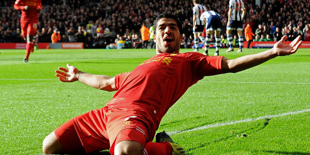 LIVERPOOL, ENGLAND - OCTOBER 26:  ( THE SUN OUT, THE SUN ON SUNDAY OUT) Luis Suarez of Liverpool celebrates his first goal during the Barclays Premier League match between Liverpool and West Bromwich Albion at Anfield on October 26, 2013 in Liverpool, England.  (Photo by Andrew Powell/Liverpool FC via Getty Images)
