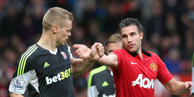 MANCHESTER, ENGLAND - OCTOBER 26:  Robin van Persie of Manchester United clashes with Ryan Shawcross of Stoke City during the Barclays Premier League match between Manchester United and Stoke City at Old Trafford on October 26, 2013 in Manchester, England.  (Photo by Matthew Peters/Man Utd via Getty Images)