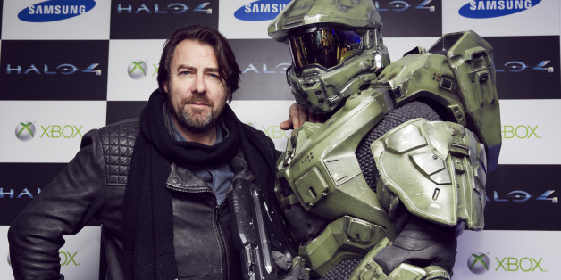 LONDON, ENGLAND  - NOVEMBER 05: Jonathan Ross and Master Chief attend the launch of Halo 4 on Xbox 360 at Tower Bridge on November 05, 2012 in London, England. The 'Halo 4' Glyph symbol is one of the largest and brightest man-made structures to ever fly over a capital city and measures 50 feet in diameter and weighs over three tons. ( Photo by Halo by Xbox360 via Getty Images )