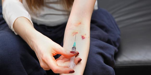 female drug addict with syringe ...