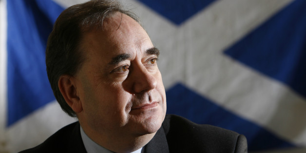 UNITED KINGDOM - JANUARY 31:  Alex Salmon, Leader of the Scottish National Party poses with the Saltire flag, the national flag of Scotland in the background at their headquarters in Edinburgh, Scotland, U.K., Tuesday, Jan. 30, 2007. As if Chancellor of the Exchequer Gordon Brown didn't have enough to worry about, his Scottish homeland may be about to vote for a party that wants to disunite the United Kingdom.  (Photo by Mike Wilkinson/Bloomberg via Getty Images)