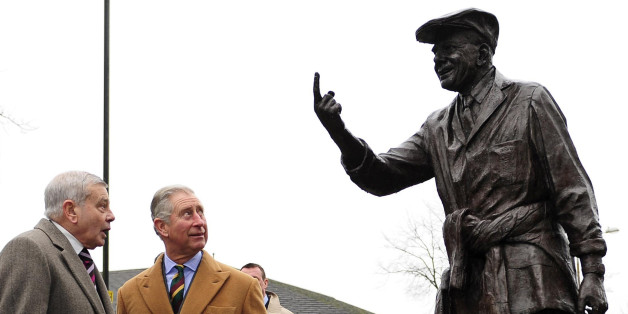 Britain's Prince Charles (2nd L) and former cricket umpire Dickie Bird (L) look at his statue in Barnsley in northern England, on January 24, 2012. Bird said he was 'humbled' to meet Prince Charles in his home town of Barnsley. He said the royal visitor discussed cricket and the current series against Pakistan in the United Arab Emirates which began with a crushing defeat for England. AFP PHOTO/John Giles/POOL (Photo credit should read JOHN GILES/AFP/Getty Images)