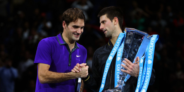 LONDON, ENGLAND - NOVEMBER 12:  Novak Djokovic of Serbia shakes hands with  Roger Federer of Switzerland as he holds the trophy following their men's singles final match against Roger Federer of Switzerland during day eight of the ATP World Tour Finals at O2 Arena on November 12, 2012 in London, England.  (Photo by Julian Finney/Getty Images)