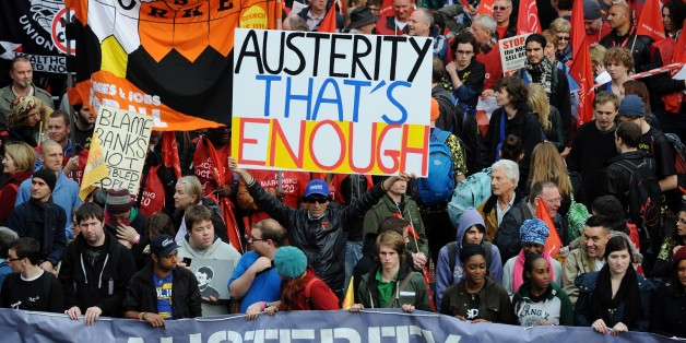Demonstrators gather in central London on October 20, 2012, as they prepare to march against the government's austerity policies and call for an alternative economic strategy that puts jobs and growth first.  Tens of thousands of people marched through London in protest against the British government's austerity measures. Union leaders were set to call for the demonstration to be followed by a general strike against the steep spending cuts introduced by Prime Minister David Cameron's coalition g