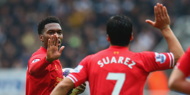 NEWCASTLE UPON TYNE, ENGLAND - OCTOBER 19:  Daniel Sturridge of Liverpool high fives Luis Suarez of Liverpool during the Barclays Premier League match between Newcastle United and Liverpool at St James' Park on October 19, 2013 in Newcastle upon Tyne, England.  (Photo by Julian Finney/Getty Images)
