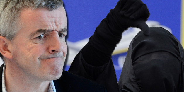 Low Cost airline Ryanair CEO Michael O'Leary reacts during a media conference outlining EU rules preventing EU staff from using budget airlines, in Brussels, Thursday, March 29, 2012.  Ryanair is criticizing the European Union for allegedly discriminating against low-fare airlines and favoring national flag carriers. (AP Photo/Yves Logghe)