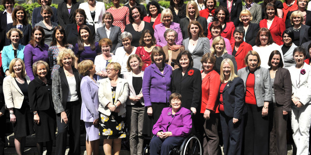 Most of the Labour Party's female MPs, including Harriet Harman (centre) gather on the steps to New Palace Yard outside the Member's Entrance to the House of Commons before they enter as the House sits for the first time since the General Election.