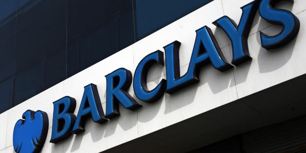 Signage for Barclays Plc is displayed outside a bank branch in Karachi, Pakistan, on Thursday, Aug. 15, 2013. Barclays, the U.K.s second-largest lender by assets, expects its Pakistan unit to post record profit this year as cost cutting measures help it weather interest rates at a seven-year low. Photographer: Asim Hafeez/Bloomberg via Getty Images