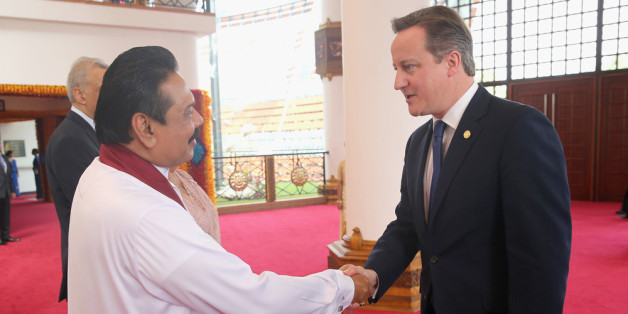 COLOMBO, SRI LANKA - NOVEMBER 15:  President Mahinda Rajapaksa of Sri Lanka greets British Prime Minister David Cameron ahead of the Commonwealth Heads of Government 2013 Opening Ceremony on November 15, 2013 in Colombo, Sri Lanka. The biannual Commonwealth Heads of Government Meeting (CHOGM) is taking place from November 15-17, amid pressure from human rights groups urging leaders to boycott the summit until Sri Lanka further investigates charges of war crimes. Both the Canadian Prime Minister,