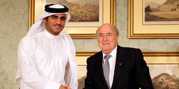 FIFA President Sepp Blatter (R) and the Chairman of Qatar 2022 bid committee Sheik Mohammed bin Hamad al-Thani (L) hold a press conference on November 9, 2013 in Doha, Qatar