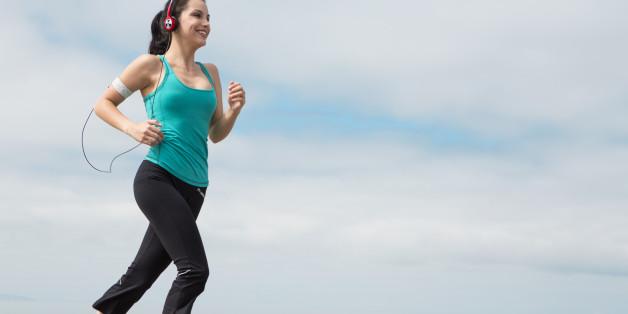 beautiful young woman jogging...
