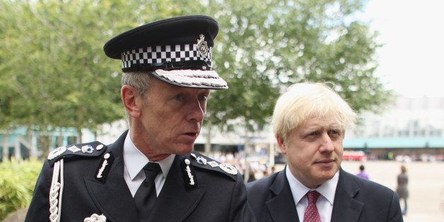 HENDON, ENGLAND - JUNE 29:  Metropolitan Police Commissioner Bernard Hogan-Howe (L) and Mayor of London Boris Johnson give an interview before newly qualified Metropolitan police officers take part in their Passing out Parade at Hendon Police Training College on June 29, 2012 in Hendon, England. The ceremony, which was overseen by the Metropolitan Police Commissioner Bernard  Hogan-Howe and Mayor of London Boris Johnson, was the largest ever Passing out Parade with 567 Specials and PCSOs becomin