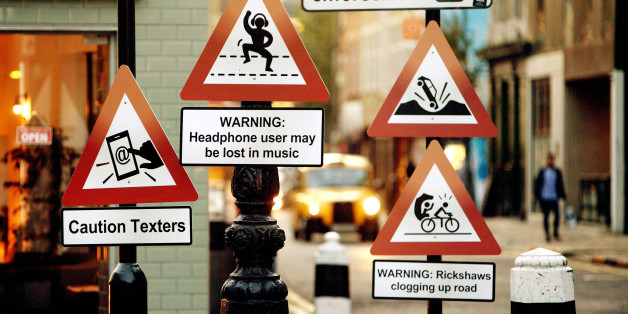 EDITORIAL USE ONLYA variety of 'road signs' positioned on a London street depicting the up to date hazards that Hailo taxi drivers believe should be part of the Highway Code.