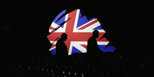 MANCHESTER, ENGLAND - OCTOBER 02:  Delegates walk past a giant model of the Conservative Party logo before British Prime Minister David Cameron delivers his keynote speech to delegates on the last day of the annual Conservative Party Conference at Manchester Central on October 2, 2013 in Manchester, England. During his closing speech David Cameron said that his 'abiding mission' would make the UK into a 'land of opportunity'.  (Photo by Oli Scarff/Getty Images)