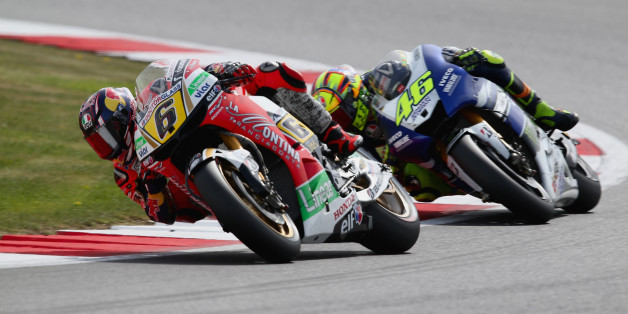 NORTHAMPTON, ENGLAND - SEPTEMBER 01: Stefan Bradl of Germany and LCR Honda Moto GP team battles with Valentino Rossi of italy and Yamaha Factory Racing during the Moto GP of Great Britain at Silverstone Circuit on September 1, 2013 in Northampton, England.  (Photo by Mark Thompson/Getty Images)