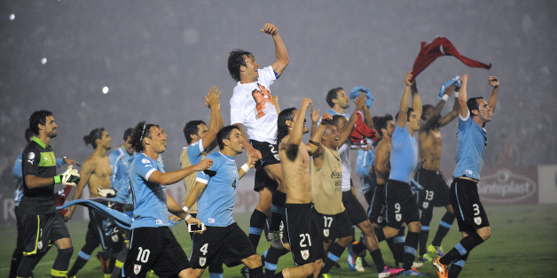 Uruguayan players celebrate after the end of the FIFA World Cup intercontinental play-offs 2nd Leg match against Jordan at the Estadio Centenario in Montevideo on November 20, 2013.  Uruguay qualify for the World Cup. AFP PHOTO / MIGUEL ROJO        (Photo credit should read MIGUEL ROJO/AFP/Getty Images)