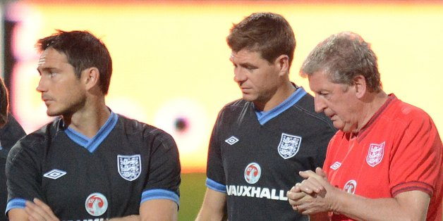(From L to R) Frank Lampard, Steven Gerrard, Coach Roy Hodgson and John Terry take part in an official training session one day ahead of World Cup 2014 qualifier match against Moldova in Chisinau city September 6, 2012. AFP PHOTO / DANIEL MIHAILESCU        (Photo credit should read DANIEL MIHAILESCU/AFP/GettyImages)