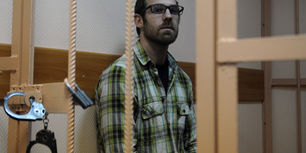 Freelance videographer Kieron Bryan from the United Kingdom, one of the 'Arctic 30,'  sits in a defendant cage in a court in Russia's second city  of Saint Petersburg, on November 18, 2013. Russia put last week the so called 'Arctic 30' in prisons in Saint Petersburg, after moving them from Murmansk where they have spent weeks in jail after their ship Arctic Sunrise was seized by Russian security forces in a commando-style operation in Arctic waters following a protest at a Gazprom oil rig. AFP