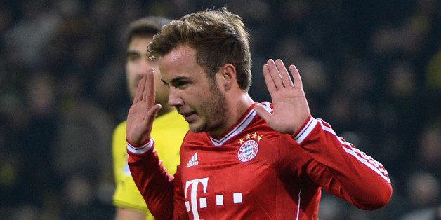 DORTMUND, GERMANY - NOVEMBER 23:  Mario Goetze of Munich celebrates after scoring the opening goal during the Bundesliga match between Borussia Dortmund and FC Bayern Muenchen at Signal Iduna Park on November 23, 2013 in Dortmund, Germany.  (Photo by Dennis Grombkowski/Bongarts/Getty Images)
