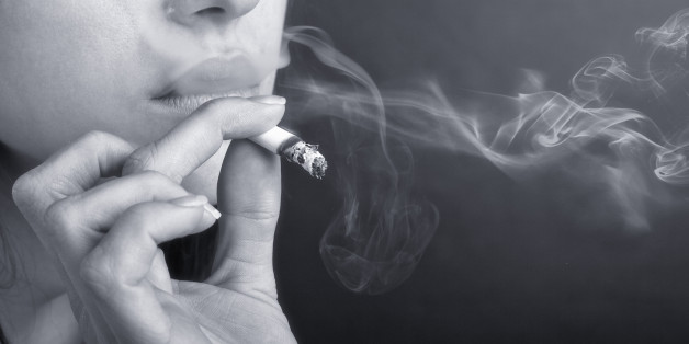 woman with cigarette exhaling...