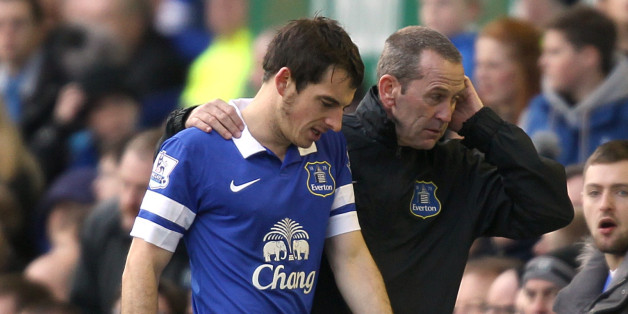 Everton's Leighton Baines is helped from the field of play after suffering an injury