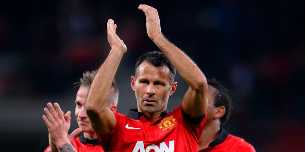 LEVERKUSEN, GERMANY - NOVEMBER 27:  Ryan Giggs of Manchester United applauds the fans during the UEFA Champions League Group A match between Bayer Leverkusen and Manchester United at BayArena on November 27, 2013 in Leverkusen, Germany.  (Photo by Lars Baron/Bongarts/Getty Images)
