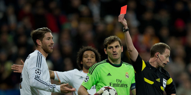 MADRID, SPAIN - NOVEMBER 27:  Referee William Collum shows the red card to Sergio Ramos of Real Madrid CF during the UEFA Champions League group B match between Real Madrid CF and Galatasaray AS at Estadio Santiago Bernabeu on November 27, 2013 in Madrid, Spain.  (Photo by Gonzalo Arroyo Moreno/Getty Images)