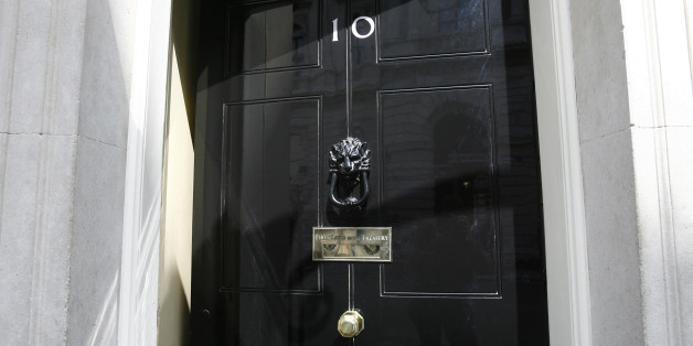 The door is opened at 10 Downing Street in Westminster, London.