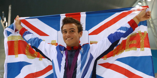 LONDON, ENGLAND - AUGUST 11:  Bronze medallist Tom Daley of Great Britain poses with the national flag after the medal ceremony for the Men's 10m Platform Diving Final on Day 15 of the London 2012 Olympic Games at the Aquatics Centre on August 11, 2012 in London, England.  (Photo by Clive Rose/Getty Images)
