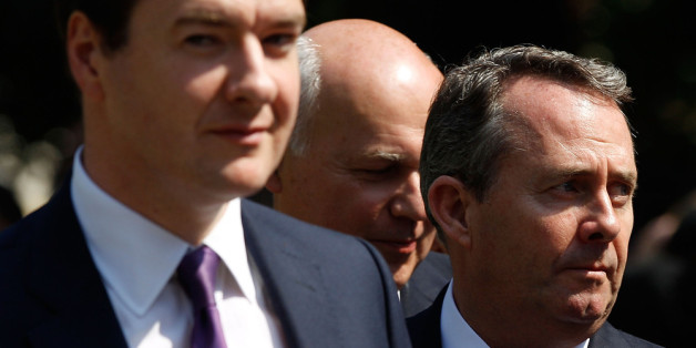 LONDON, ENGLAND - JULY 04:  Chancellor George Osborne, Work and Pensions Secretary Iain Duncan Smith and Defence Secretary Liam Fox look towards the media after a statue of former U.S. President Ronald Reagan was unveiled in the grounds of the American Embassy on July 4, 2011 in London, England. Today would have been Reagan's 100th Birthday. The 40th President of the United States of America enjoyed close ties with the British Prime Minister Margaret Thatcher.  (Photo by Matthew Lloyd/Getty Imag