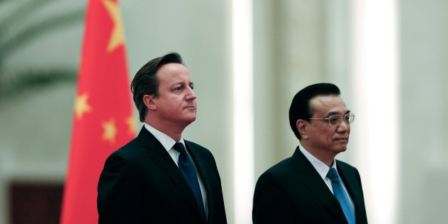 BEIJING, CHINA - DECEMBER 02:  Chinese Premier Li Keqiang (R) invites British Prime Minister David Cameron (L) to view an honour guard during a welcoming ceremony inside the Great Hall of the People on December 2, 2013 in Beijing, China. At the invitation of Chinese Premier Li Keqiang, British Prime Minister David Cameron will pay an official visit to China from December 2 to 4.  (Photo by Lintao Zhang/Getty Images)