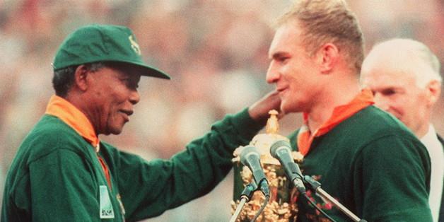 South Africa captain François Pienaar receives the Webb Ellis trophy from Mandela in 1995
