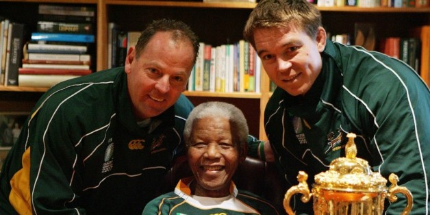 JOHANNESBURG, SOUTH AFRICA - 27:  Former South Africa President Nelson Mandela poses with South Africa Rugby Union coach Jake White (L), South Africa Rugby Union captain John Smit (R) and the Webb-Ellis cup during the Springboks visit to Nelson Mandela at his residence on October 27, 2007 in Houghton, Johannesburg, South Africa. South Africa became the current holders of the cup after defeating Former champions England 15-6 in the 2007 Rugby World Cup Final. (Photo by Lefty Shivambu/Gallo Images/Getty Images)