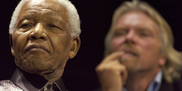 SOUTH AFRICA - JULY 18:  Former South African President Nelson Mandela, left, and U.K. billionaire Richard Branson listen to Peter Gabriel sing 'Biko,' in Johannesburg, South Africa, on Wednesday, July 18, 2007. Mandela, South Africa's first black president and a Nobel peace prize winner, today announced the formation of a global think-tank of world leaders called The Elders. He used his 89th birthday today to launch the group.  (Photo by Greg Marinovich/Bloomberg via Getty Images)