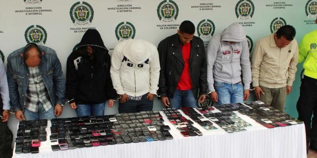 Alleged stolen smartphone traffickers and their merchandise