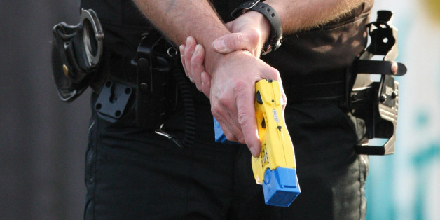 PC Terry Allan holds a Taser stun gun during at at the Police Headquarters in Ponteland, England.