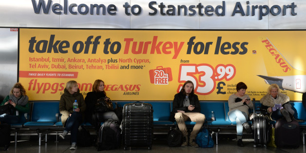 "Passengers wait at Stansted Airport, Essex, after a ""technical problem"" at the National Air Traffic Services (Nats) control centre in Swanwick, Hampshire, caused delays at airports across the UK."