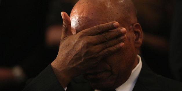 JOHANNESBURG, SOUTH AFRICA - DECEMBER 08:  South African President Jacob Zuma rubs his eyes during a service at Bryanston Methodist Church during a national day of prayer, on December 8, 2013 in Johannesburg, South Africa. Mandela, also known as Madiba, passed away on the evening of December 5th, 2013 at his home in Houghton at the age of 95. Mandela became South Africa's first black president in 1994 after spending 27 years in jail for his activism against apartheid in a racially-divided South